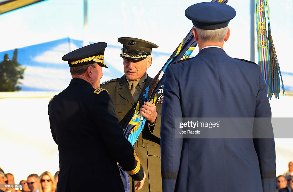 U.S. Marine General John F. Kelly (C) receives the Command flag from U.S Army General Martin E. Dempsey, Chairman, Joint Chiefs of Staff, (L) and the outgoing commander U.S. Air Force General Douglas Fraser during a change of command ceremony at United States Southern Command on November 19, 2012 in Doral, Florida. U.S. Marine Gen. John Kelly takes over the command from U.S. Air Force Gen. Douglas Fraser.