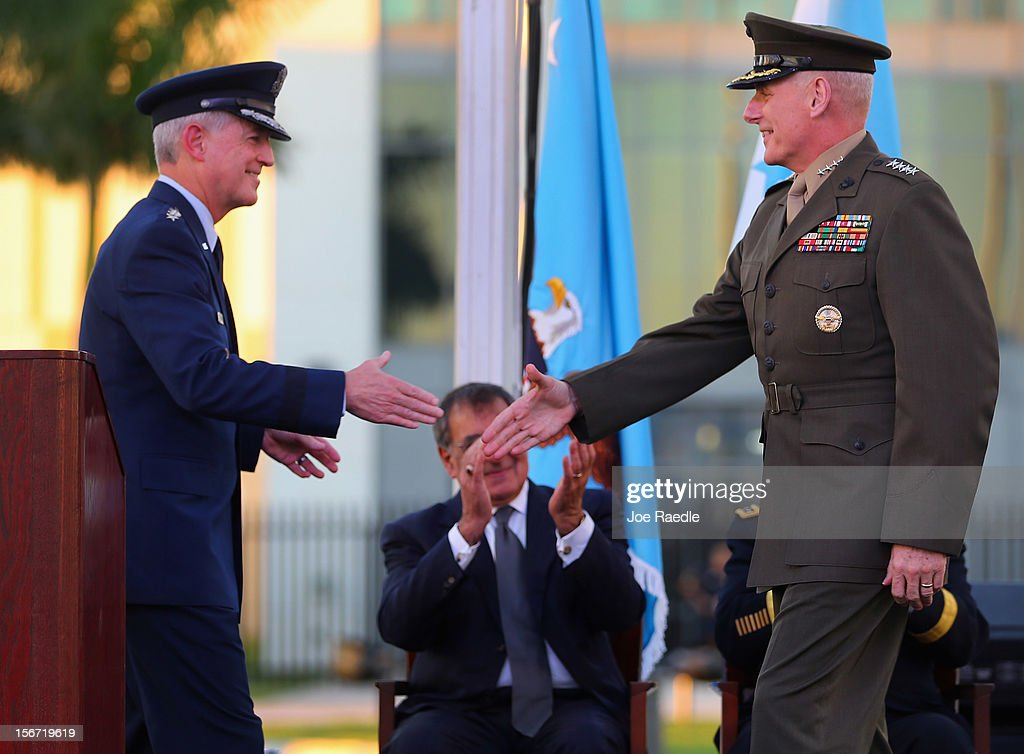 U.S. Marine General John F. Kelly (R) shakes hands with the outgoing commander U.S. Air Force General Douglas Fraser during a change of command ceremony at United States Southern Command on November 19, 2012 in Doral, Florida. U.S. Marine Gen. John Kelly takes over the command from U.S. Air Force Gen. Douglas Fraser.