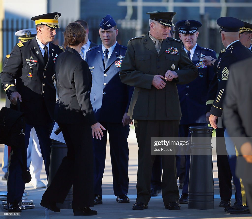 U.S. Marine General John F. Kelly (2nd R) waits for the start of the change of command ceremony at the United States Southern Command on November 19, 2012 in Doral, Florida. U.S. Marine Gen. John Kelly takes over the command from U.S. Air Force Gen. Douglas Fraser.