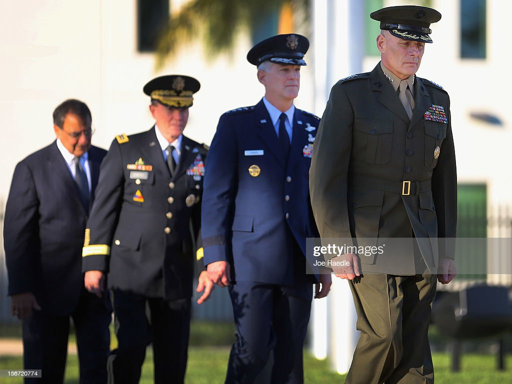 U.S. Marine General John F. Kelly (front to back) walks with U.S. Air Force General Douglas Fraser, U.S. Army General Martin Dempsey and U.S. Secretary of Defense Leon Panetta, Secretary of Defense, during a change of command ceremony at United States Southern Command on November 19, 2012 in Doral, Florida. U.S. Marine Gen. John Kelly takes over the command from U.S. Air Force Gen. Douglas Fraser.