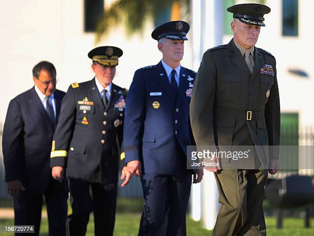 S Marine General John F Kelly walks with US Air Force General Douglas Fraser US Army General Martin Dempsey and US Secretary of Defense Leon Panetta...