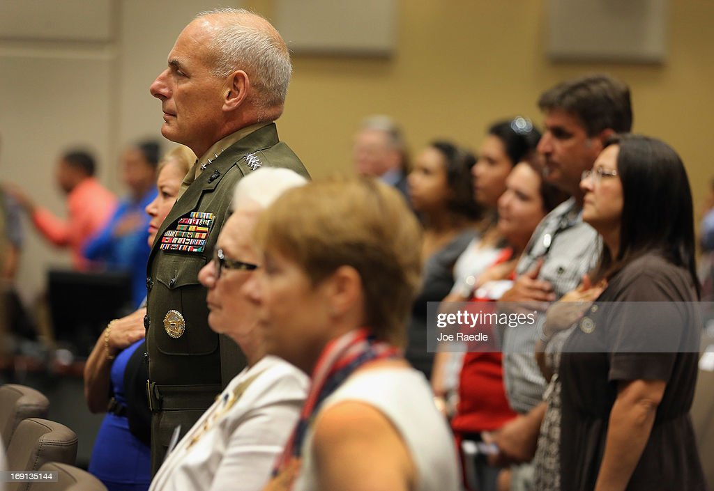 U.S. Marine General John Kelly stands at attention while the National Anthem is played during a ceremony to remember and honor those who have died in service to the nation and the families they have left behind at U.S. Southern Command headquarters on May 20, 2013 in Doral, Florida. U.S. Marine Gen. John Kelly presided over the ceremony where the families of 57 fallen service members from South Florida were invited to attend.