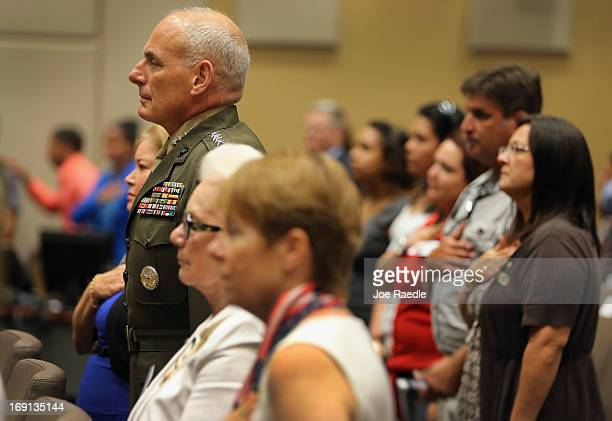 S Marine General John Kelly stands at attention while the National Anthem is played during a ceremony to remember and honor those who have died in...