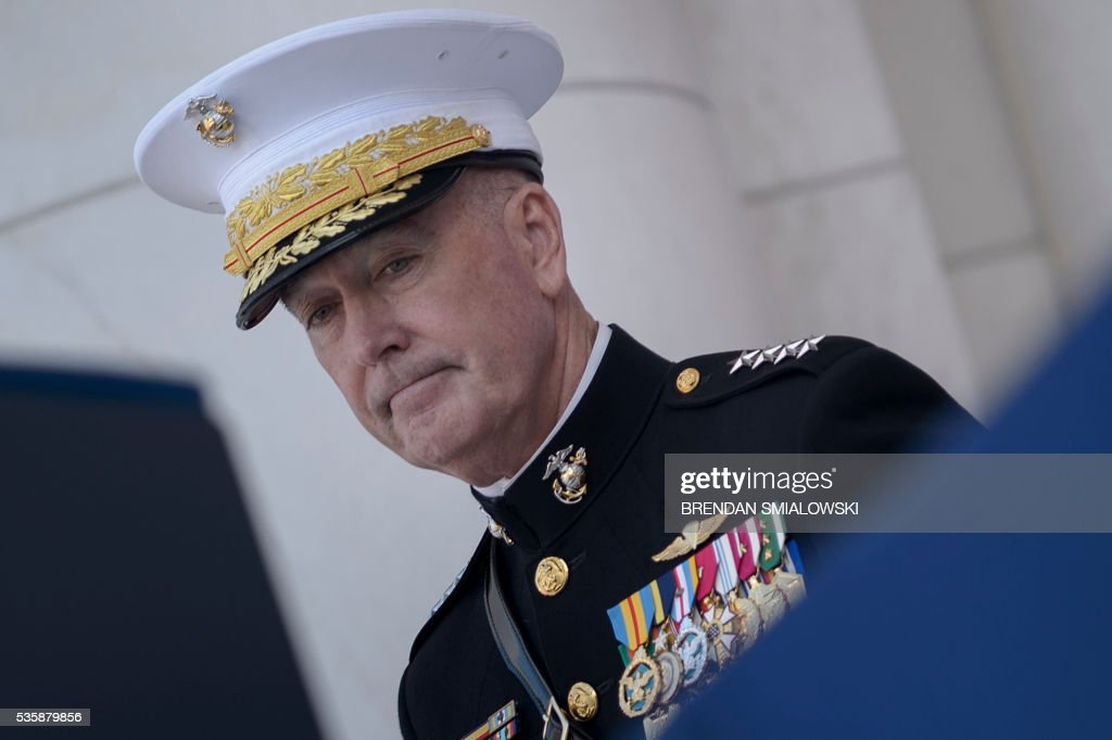 Marine General Joseph Dunford, Chairman of the Joint Chiefs of Staff, waits for US President Barack Obama to speak during an event to honor Memorial Day at Arlington National Cemetery May 30, 2016 in Arlington, Virginia. / AFP / Brendan Smialowski