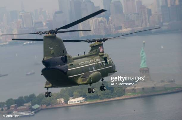 Marine helicopter supporting the visit of US President Barack Obama flies over the Statue of Liberty enroute to lower Manhattan as Obama arrives in...