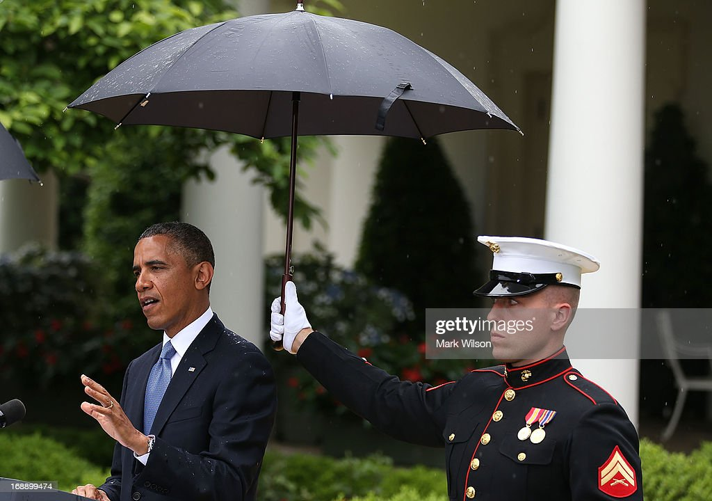 S. Marine holds an umbrella over U.S. President <a gi-track='captionPersonalityLinkClicked' href=/galleries/search?phrase=Barack+Obama&family=editorial&specificpeople=203260 ng-click='$event.stopPropagation()'>Barack Obama</a> as he and Prime Minister Recep Tayyip Erdogan of Turkey (not shown) speak to the media in the Rose Garden at the White House May 16, 2013 in Washington, DC. The two leaders spoke about the fighting in Syria, and President Obama answered questions on the IRS Justice Department invesigation.