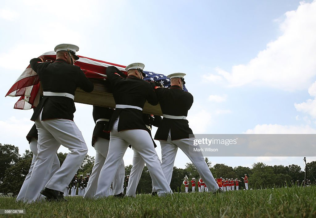 Marine honor guard team carries the remains of US Marine PFC Anthony Brozyna of Hartford CT during a full honor burial service at Arlington National...