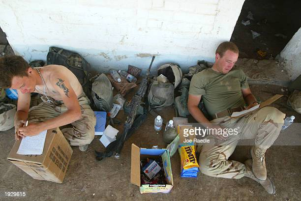 Marine Lance Corporal Lance Corporal Marshall E Biles from Parkersburg West Virginia and PFC Jon Abbott from Austin Texas of Task Force Tarawa 1/2...