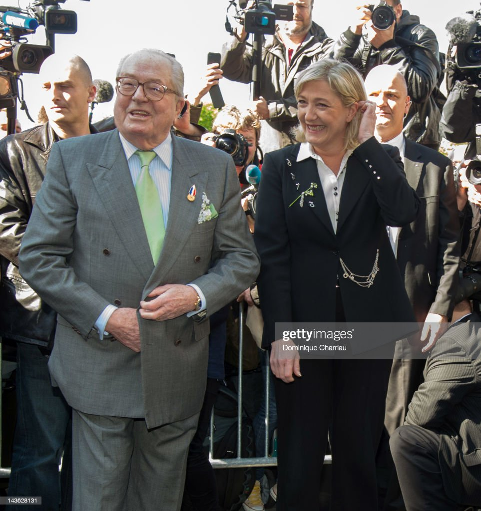 Marine Le Pen (R) and her father Jean-Marie Le Pen attend the French Far Right Party May Day demonstration on May 1, 2012 in Paris, France. Marine Le Pen, the daughter of the French far-right leader Jean-Marie Le Pen, received only 6.4 million votes in the first round of the presidential elections. Both Sarkozy and Hollande are now fighting to win support from the French Far Right ahead of the second round.