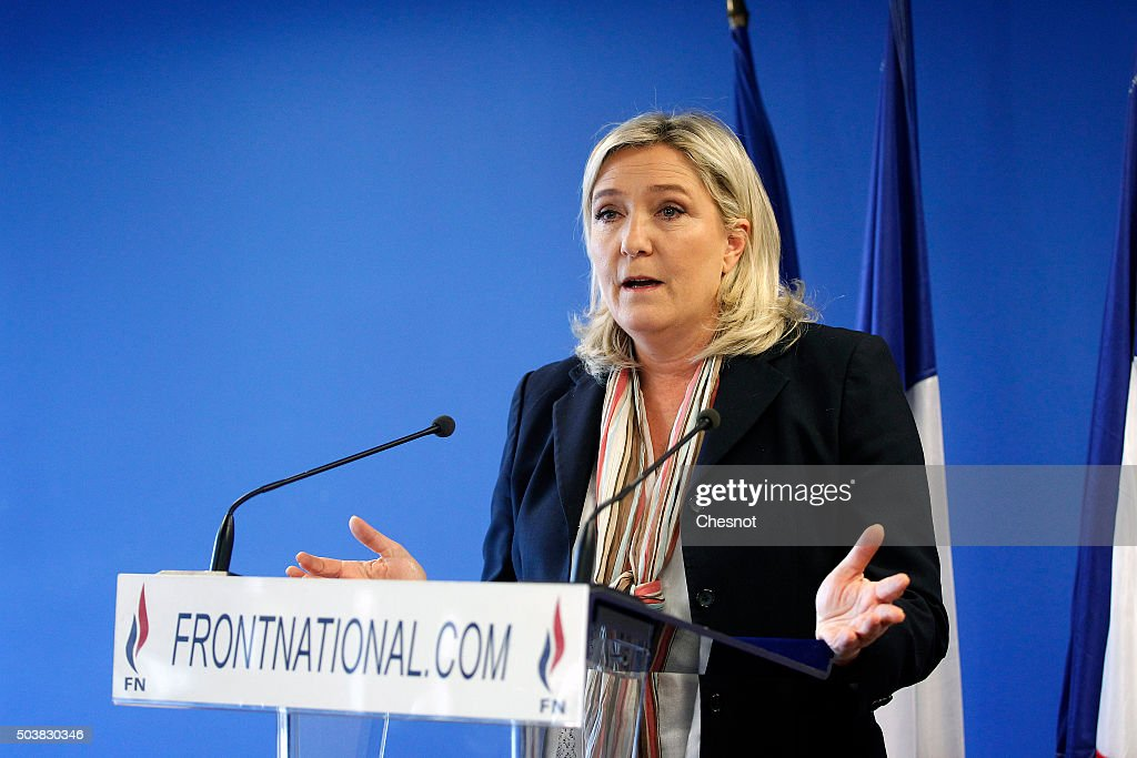 Marine Le Pen France's farright National Front President delivers a speech on January 7 2016 in Nanterre France Marine Le Pen presents her New Year...