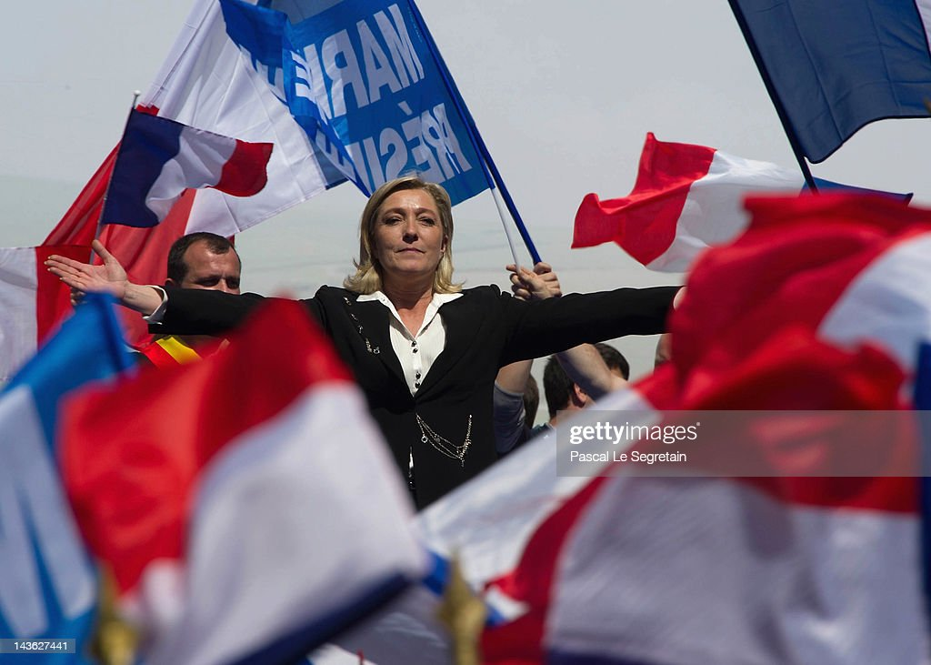Marine Le Pen gestures as she delivers a speech during the French Far Right Party May Day demonstration on May 1, 2012 in Paris, France. Marine Le Pen, the daughter of the French far-right leader Jean-Marie Le Pen, received only 6.4 million votes in the first round of the presidential elections. Both current French President Nicolas Sarkozy and French Socialist Party candidate Francois Hollande are now fighting to win support from the French Far Right ahead of the second round elections on May 6.