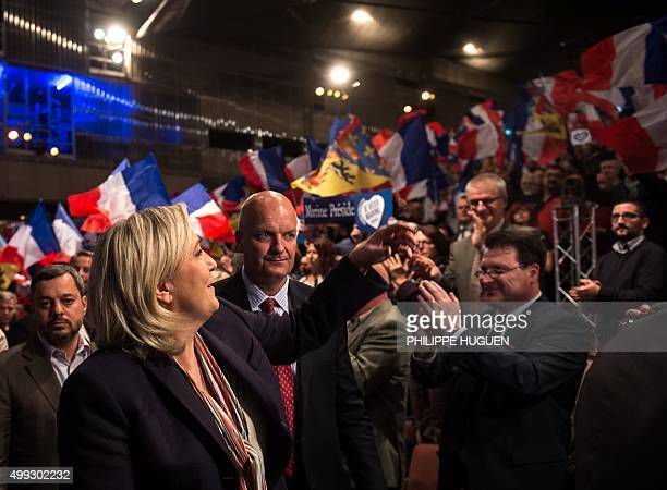 Marine Le Pen leader of the French farright Front National party waves to supporters during her campaign rally for the upcoming regional elections in...