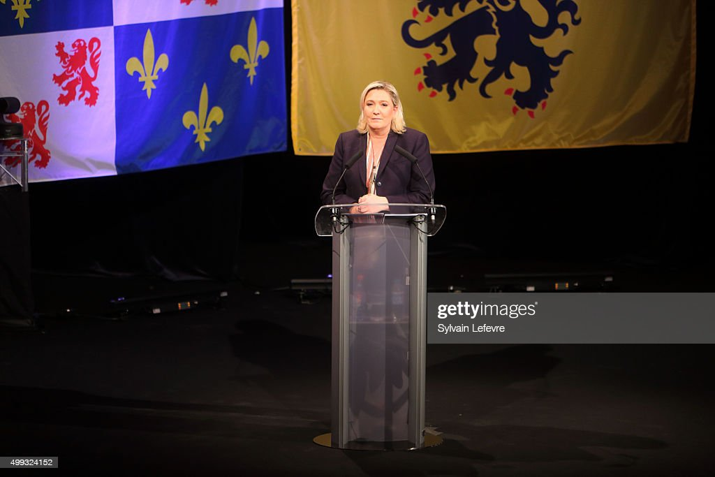Marine Le Pen, leader of the French far-right National Front (FN) party, gives a speech during her campaign rally for the upcoming regional elections in the Nord-Pas de Calais-Picardie, on November 30, 2015 in Lille, France.