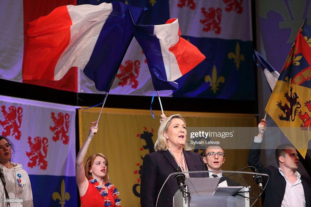 Marine Le Pen leader of the French farright National Front party sings national hymn 'La Marseillaise' at the of her campaign rally for the upcoming...