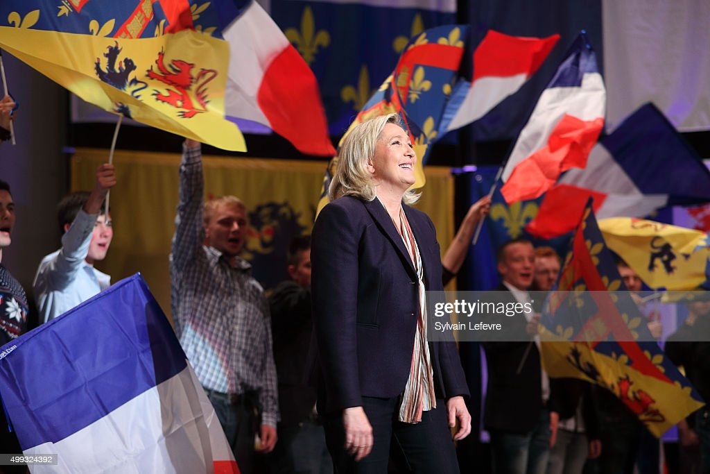 Marine Le Pen leader of the French farright National Front party smiles during her campaign rally for the upcoming regional elections in the NordPas...