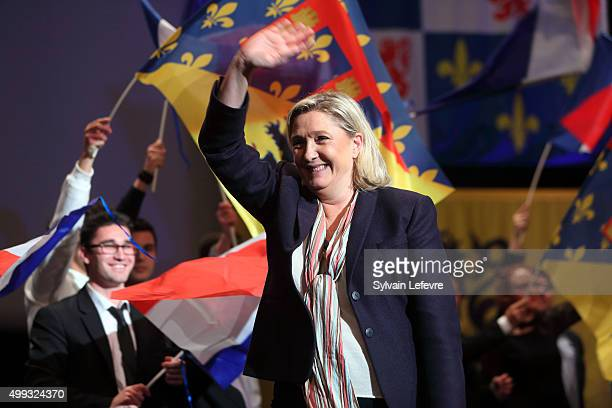 Marine Le Pen leader of the French farright National Front party waves to supporters during her campaign rally for the upcoming regional elections in...