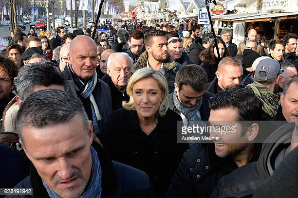 Marine Le Pen President of the French far right political party Front National visits the Christmas Market on the Champs Elysees on December 8 2016...