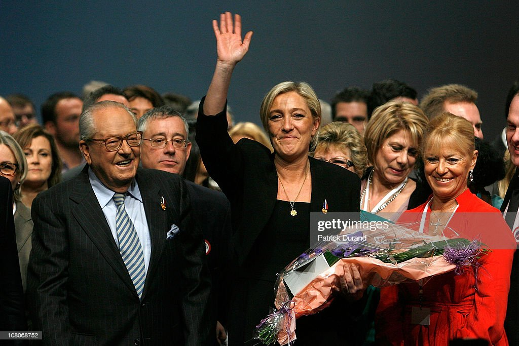 Marine Le Pen salutes the party members as she is named as France's far-right nationalist party, Front National's new leader at a party conference on January 16, 2011 in Tours, France. Marine Le Pen, 42, daughter of outgoing leader Jean-Marie Le Pen, has been elected to lead the party with a 67% majority, beating 60-year-old Bruno Gollnisch.