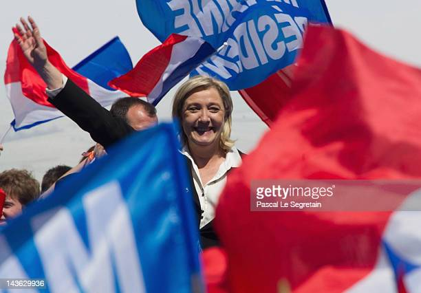 Marine Le Pen waves to her supporters during the French Far Right Party May Day demonstration on May 1 2012 in Paris France Marine Le Pen the...