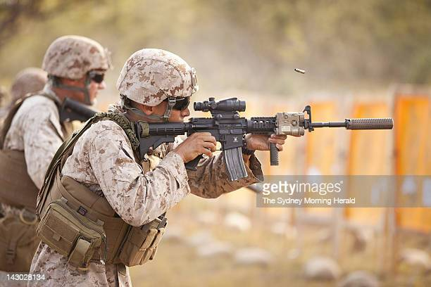 US Marine Lieutenant Corporal Carlos Vasquez of Fox Company participates in combat marksmanship training at the Australian Defence Force's Kangaroo...