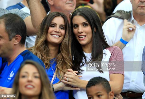 Marine Lloris wife of France goalkeeper Hugo Lloris with Ludivine Sagna wife of France's Bacary Sagna in the stands before the game