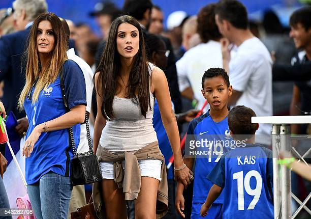 Marine Lloris wife of France's goalkeeper Hugo Lloris speaks with Ludivine Sagna wife of France's defender Bacary Sagna at the end of the Euro 2016...