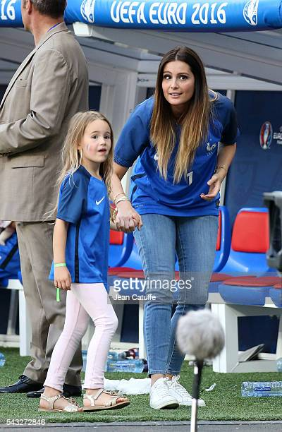 Marine Lloris wife of Hugo Lloris and their daughter Anna Rose Lloris look on following the UEFA EURO 2016 round of 16 match between France and...