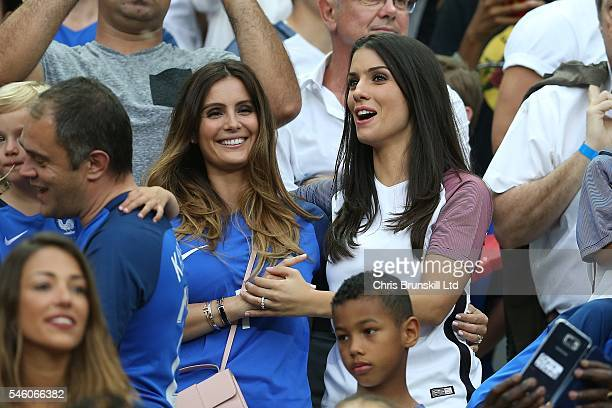 Marine Lloris wife of Hugo Lloris of France looks on next to Ludivine Sagna wife of teammate Bacary Sagna during the UEFA Euro 2016 Final match...