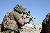 October 20, 2010 - A U.S. Marine looks through the scope of an M40A1 sniper rifle at a patrol base near Sangin, Afghanistan. The battalion conducted counterinsurgency operations to support the Interna