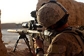October 20, 2010 - U.S. Marine with Scout Sniper Platoon, looks through the scope of his M16A4 rifle for enemy forces during a patrol in Sangin Valley, Afghanistan. The battalion conducted counterinsu