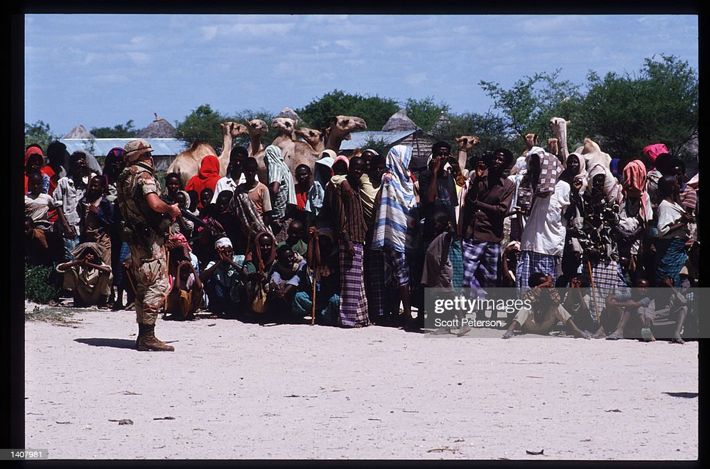 A marine maintains order during food distribution January 15 1993 in Bur Hakaba Somalia US troops arrived in 1992 marking the beginning of a UN...