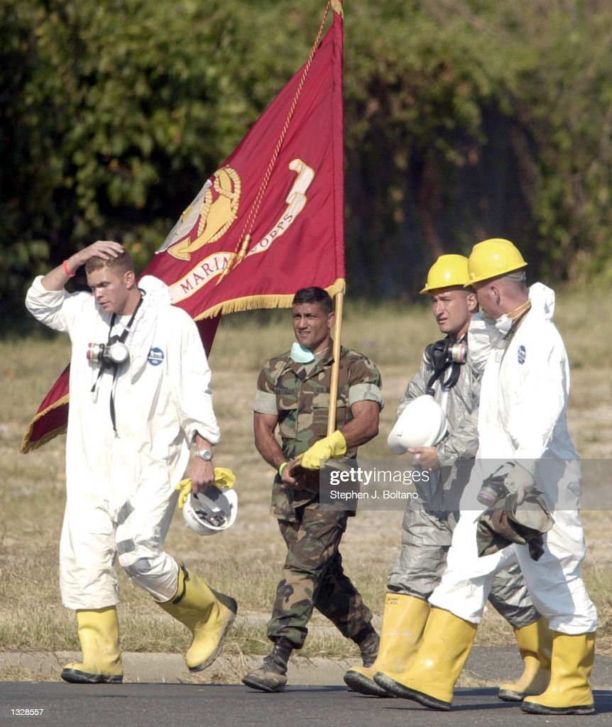 Marine Major Dan Pantaleo (R) walks with a unscathed marine corp flag he removed from the Pentagon crash site September 13, 2001 in Arlington, VA. He plans to take it to the Commandant of the Marine Corps office.