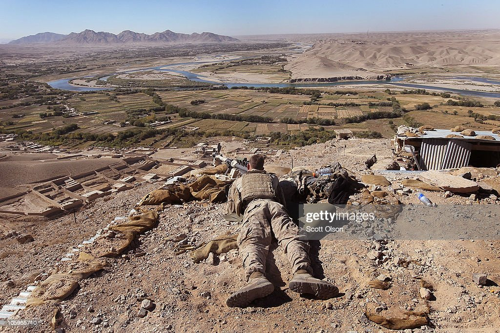 S Marine marksman Cpl Jacob Hoag of Bend OR with India Battery 3rd Battalion 12th Marine Regiment provides security for a patrol at outpost West...