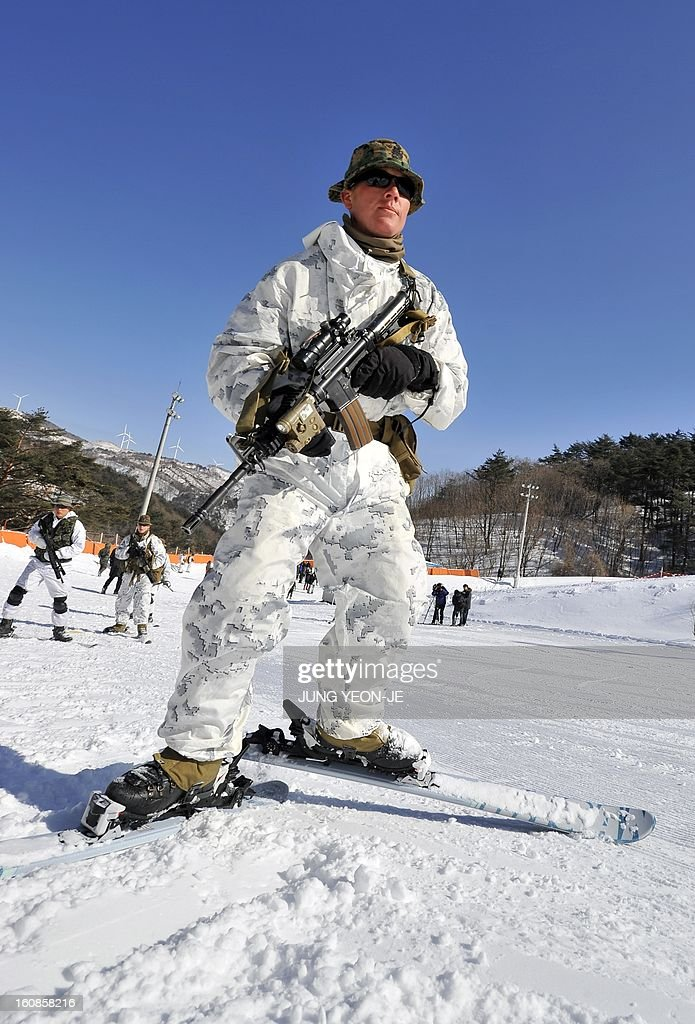 Marine moves on skis during a joint winter drill in Pyeongchang, some 180 kilometers east of Seoul, on February 7, 2013. Marines from South Korea and the United States took part in a military winter drills, which began on February 4 and run through February 22, to test their limits in extreme conditions.