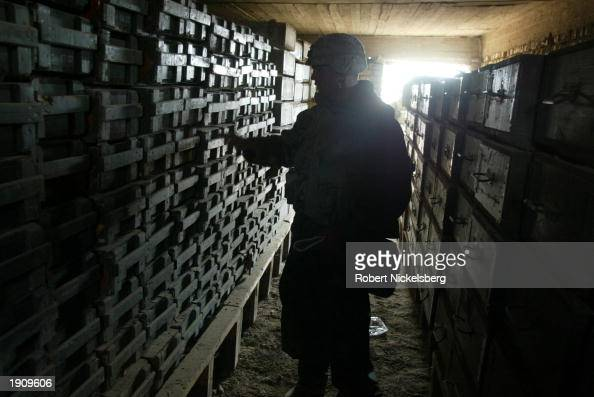 A US Marine of the 1st Marine Division takes inventory of an enormous Iraqi weapons armory April 1 2003 in Diwaniya Iraq Diwaniya a city of 300000...