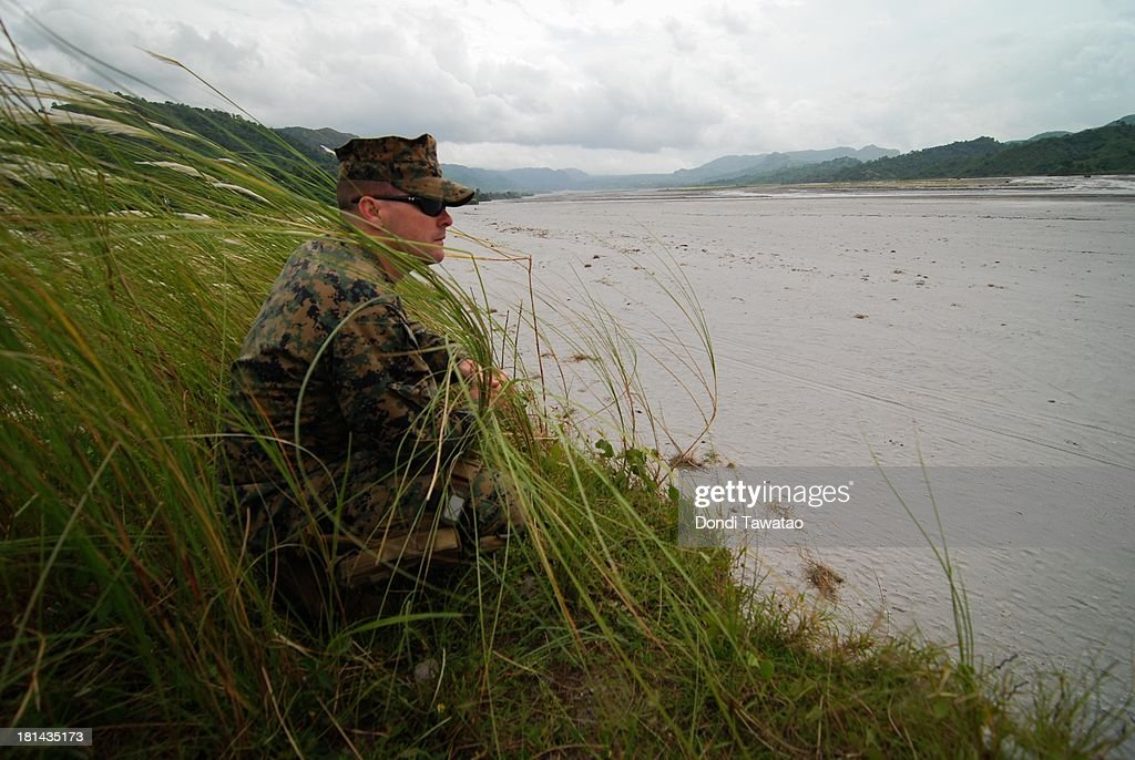 S. Marine officer take part in a military training exercise in Crow Valley, September 21, 2013 in Tarlac province, Philippines. Around three thousand U.S. Marines are in the country for the Phiblex amphibious marine exercise with their Philippine counterparts. The war games maneuvers run for three weeks in various locations in the Philippines.