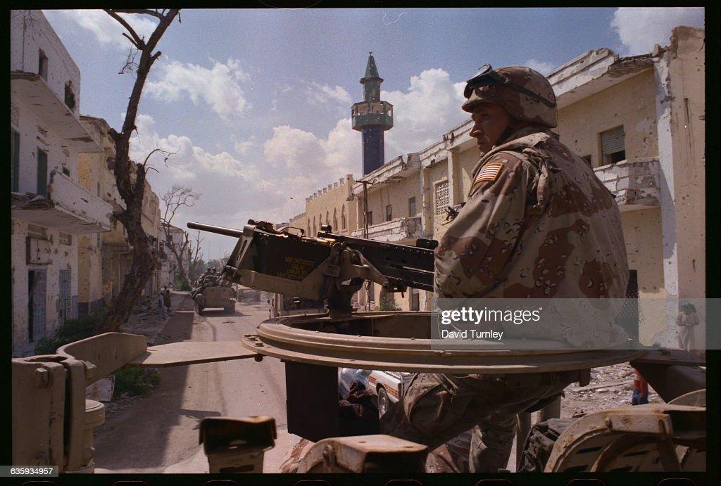Marine on patrol in a truck in Mogadishu