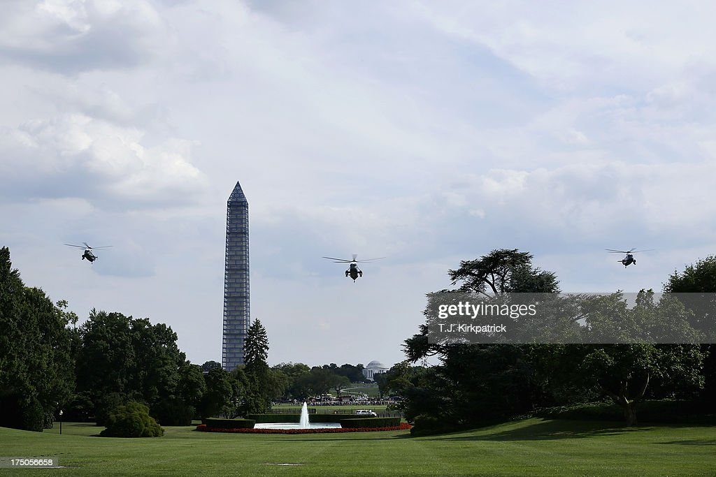 Marine One and two decoy helicopters fly toward the White House as U.S. President Barack Obama returns after speaking at the Amazon Fulfilment Center in Tennessee, on July 30, 2013 in Washington, DC. In his speech the president attacked republican efforts at job creation, including the Keystone XL pipeline, shrinking the Environmental Protection Agency, and repeated attempts in Congress to repeal the Affordable Care Act.