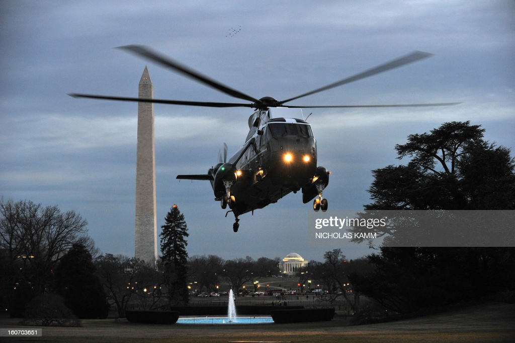 Marine One carrying US President Barack Obama descends on to the South Lawn as Obama returns to the White House in Washington on February 4, 2013. Obama traveled to Minneapolis to tout his gun control proposals. AFP PHOTO/Nicholas KAMM