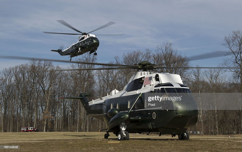 Marine One, carrying U.S. President Barack Obama lands behind a support helicopter, as he arrives at Walter Reed National Military Medical Center to visit wounded military personnel on March 5, 2013 in Bethesda, Maryland. Later today Obama and Vice President Biden will meet with newly instated Defense Secretary Chuck Hagel in the Oval Office.