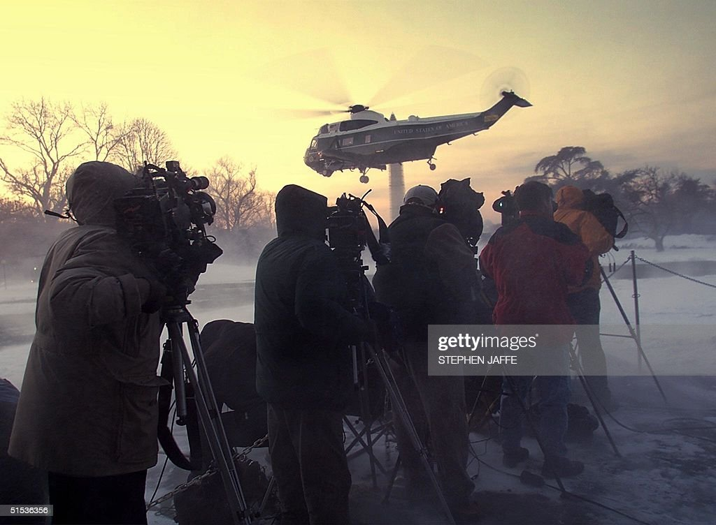 Marine One carrying US President Bill Clinton departs from the South Lawn of the White House blowing snow around the media 21 January 2000 in Washington. President Clinton is headed to California to attend fundraisers. (ELECTRONIC IMAGE) AFP PHOTO/Stephen JAFFE