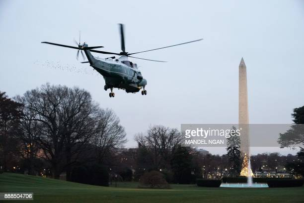 Marine One carrying US President Donald Trump takes off from the South Lawn of the White House on December 8 2017 in Washington DC Trump is heading...