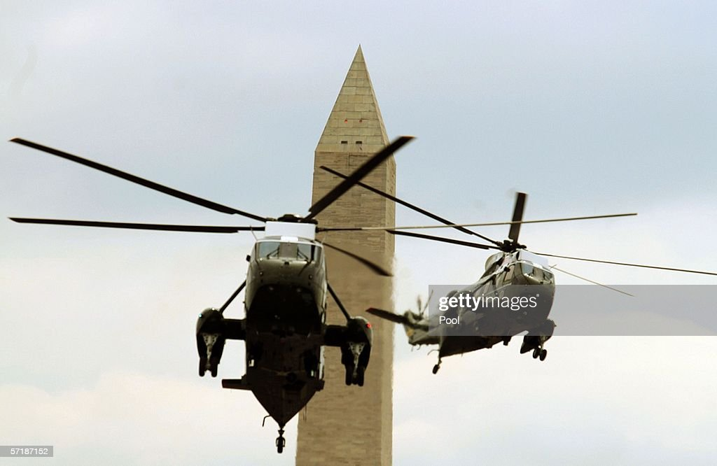 Marine One (L), carrying U.S. President George W. Bush, and another helicopter, arrive at the White House March 26, 2006 in Washington, DC. President Bush spent his weekend at Camp David.