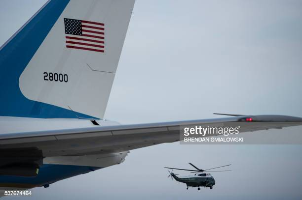 Marine One flies past Air Force One as it carries US President Barack Obama from Andrews Air Force Base to the White House June 2 2016 in Maryland...