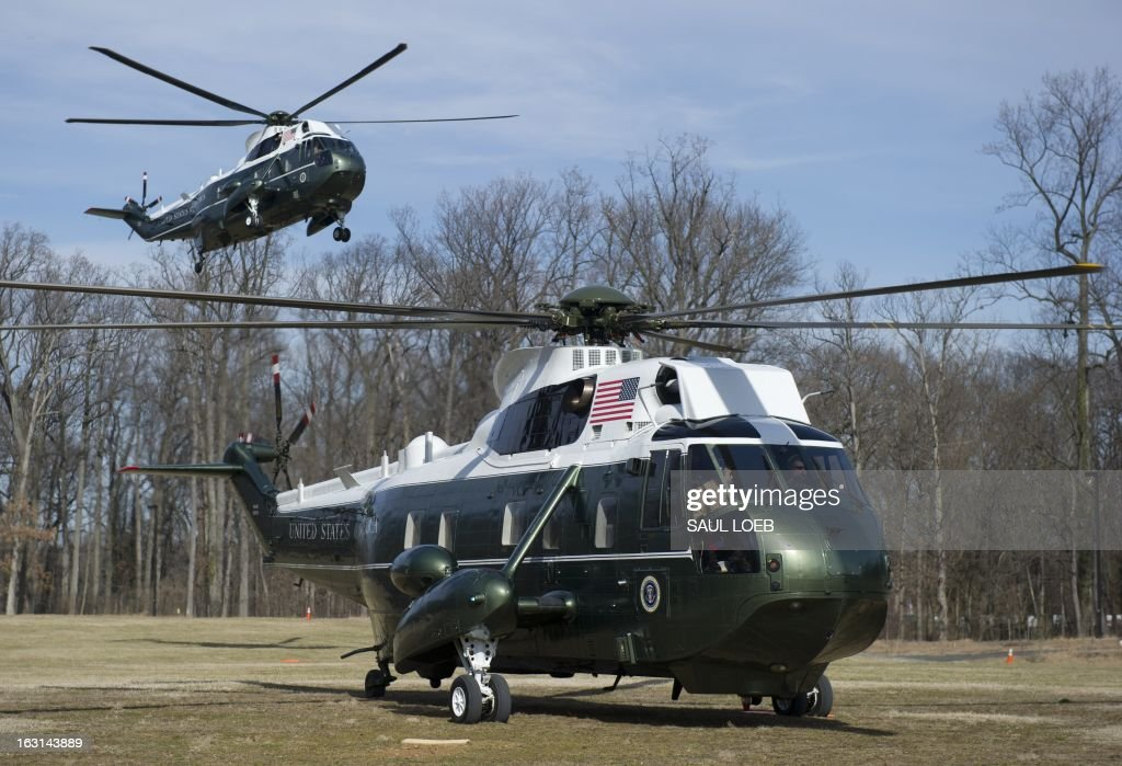 Marine One helicopter with US President Barack Obama aboard (L) arrives at Walter Reed National Military Medical Center in Bethesda, Maryland, March 5, 2013, alongside a support helicopter. Obama is visiting with wounded warriors who are being treated at the hospital and their families. AFP PHOTO / Saul LOEB