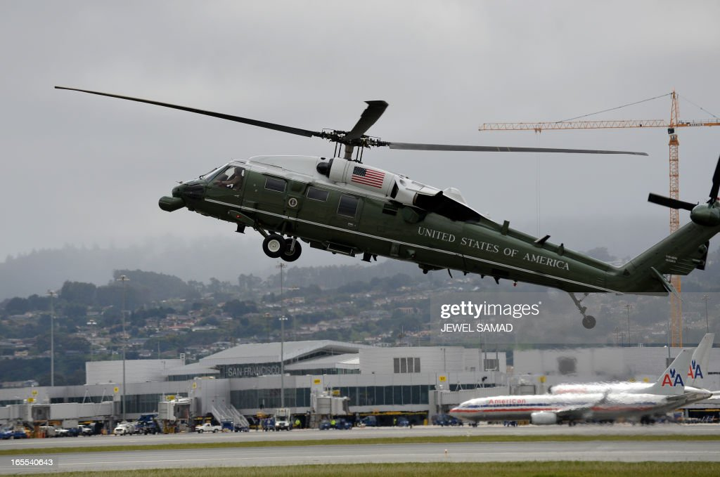 Marine One helicopter with US President Barack Obama on board preapres to land at San Francisco International Airport in San Francisco, California, on April 4, 2013. AFP PHOTO/Jewel Samad