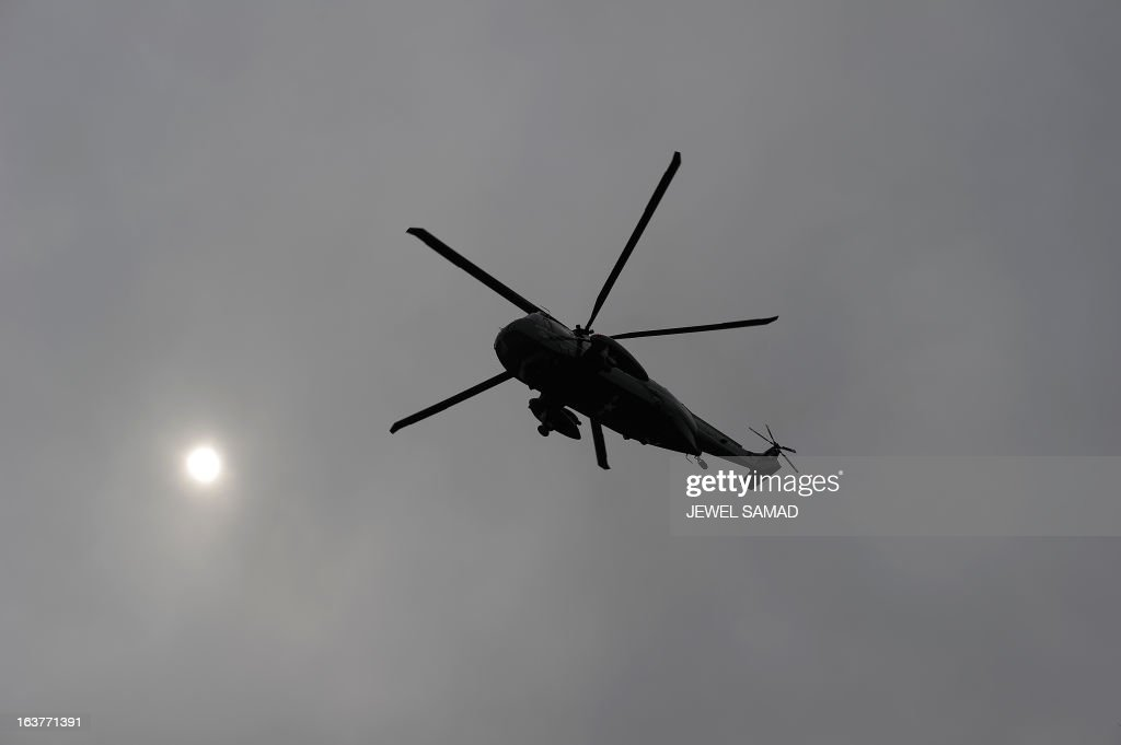 Marine One helicopter with US President Barack Obama onboard prepares to land in Argonne, Illinois, on March 15, 2013 as he arrive to tour the Argonne National Laboratory before speaking on American energy. AFP PHOTO/Jewel Samad