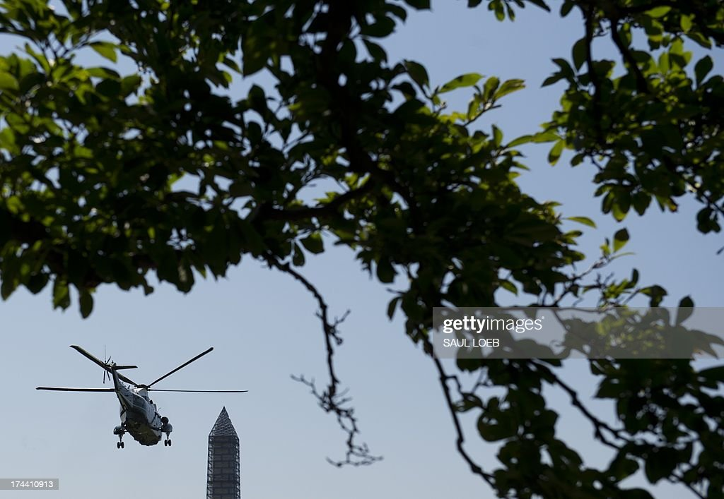 Marine One, with US President Barack Obama aboard, departs from the South Lawn of the White House in Washington, DC, July 25, 2013, as he travels to Jacksonville, Florida, to speak on the economy. AFP PHOTO / Saul LOEB