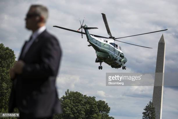Marine One with US President Donald Trump and First Lady Melania Trump onboard departs the South Lawn of the White House near the Washington Monument...