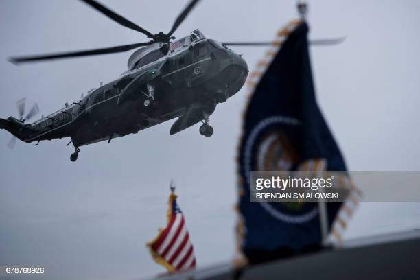 Marine One with US President Donald Trump lands at the Wall Street Heliport May 4 2017 in New York New York Trump is returning to New York for the...